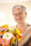 Portrait of happy senior woman with flowers royalty free stock photos