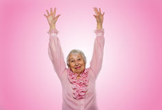 Portrait of a happy senior woman gesturing victory over pink Royalty Free Stock Photos