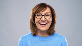 Portrait of happy senior woman in glasses stock video