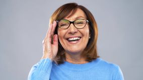 Portrait of happy senior woman in glasses stock video footage