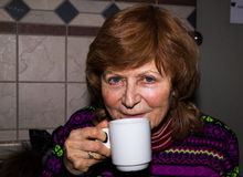 Portrait of a happy senior woman. Portrait of a happy senior woman, grandmother drinking coffee Royalty Free Stock Photos