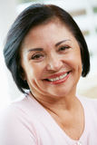 Portrait Of Happy Senior Woman At Home stock photography
