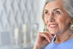 Portrait of happy senior woman at home. Portrait of happy beautiful senior woman posing at home stock image