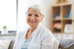 Portrait of happy senior woman laughing royalty free stock photo