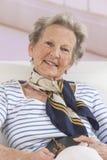 Portrait of happy senior woman in living room stock photos