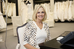 Portrait of a happy senior woman sitting in bridal store Royalty Free Stock Photo