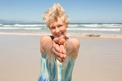 Portrait of happy senior  woman standing against clear sky. At beach Royalty Free Stock Photos