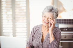 Portrait of happy senior woman talking on mobile phone Stock Photos
