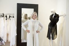 Portrait of a happy senior woman trying on clothes in fashion boutique Stock Image
