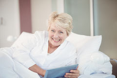 Portrait of happy senior woman using digital tablet Stock Photography