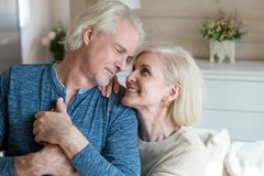 Happy romantic senior husband and wife shooting holding hands stock images