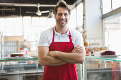 Portrait of happy server with arms crossed Stock Photos