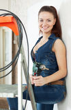 Portrait of happy sexy girl  with drill Royalty Free Stock Photography