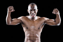 Portrait of happy shirtless athlete cheering Stock Image