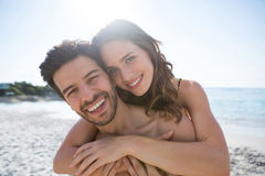 Portrait of happy shirtless couple embracing at beach Royalty Free Stock Photography