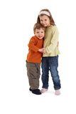 Portrait of happy siblings. Hugging each other, smiling at camera Stock Image