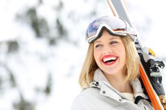 Happy skier holding skis looking at side Stock Images