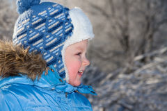 Portrait happy small child the boy on walk in the winter in park Stock Images
