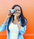 Portrait happy smiling african woman with old vintage camera Stock Photo