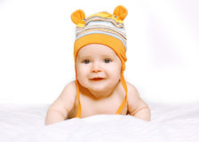 Portrait happy smiling baby in hat. On the bed Stock Photos