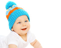 Portrait of happy smiling baby wearing a blue knitted hat Stock Photos