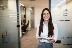 Portrait of happy smiling beautiful brunette businesswoman royalty free stock photo