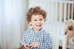 Portrait of happy smiling beautiful little boy in babyroom - checked shirt Stock Image