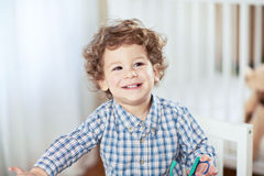 Portrait of happy smiling beautiful little boy in babyroom - checked shirt Stock Images