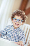 Portrait of happy smiling beautiful little boy with glasses in babyroom - checked shirt Royalty Free Stock Photos
