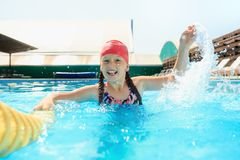 The portrait of happy smiling beautiful teen girl at the pool stock image