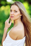 Portrait of happy smiling beautiful young woman touching skin Royalty Free Stock Photo