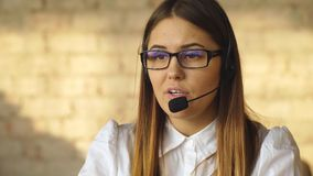 Portrait of happy smiling blonde female customer support phone operator stock footage