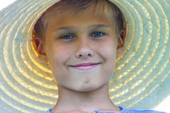 Portrait of happy smiling boy with straw hat outdoor Royalty Free Stock Images