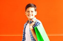 Portrait happy smiling boy teenager with shopping bag in city royalty free stock image