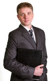 Portrait of happy smiling businessman with folde Royalty Free Stock Photography