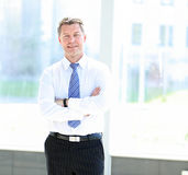 Portrait of happy smiling businessman in a modern office Royalty Free Stock Photos