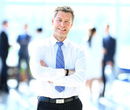 Portrait of happy smiling businessman in a modern office Stock Images