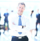 Portrait of happy smiling businessman in a modern office Royalty Free Stock Images