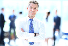 Portrait of happy smiling businessman in a modern office Royalty Free Stock Photography