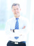 Portrait of happy smiling businessman in a modern office Stock Photos
