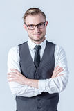 Portrait of  happy smiling businessman standing with arms crosse Stock Photo