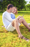 Portrait of Happy smiling Caucasian Couple Sitting Together On t Stock Photography