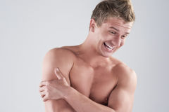 Portrait Of happy Smiling Caucasian Man Posing with Naked Torso. Royalty Free Stock Photo