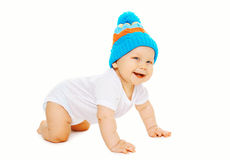 Portrait happy smiling cheerful baby crawls in knitted hat Stock Photo