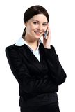 Portrait of happy smiling cheerful beautiful young businesswoman with phone Stock Photos