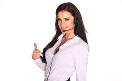Portrait of happy smiling cheerful support phone operator in headset. Royalty Free Stock Photo