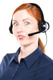 Portrait of happy smiling cheerful support phone operator. In headset. Make funny face. Isolated on white background Royalty Free Stock Images