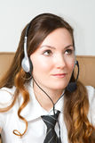 Portrait of happy smiling cheerful support phone operator in headset at office. Royalty Free Stock Images