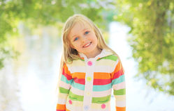 Portrait happy smiling child outdoors in summer Stock Photo