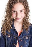 Portrait of happy, smiling, confident 9 years old girl with curly hair, isolated on white. A Portrait of happy, smiling, confident 9 years old girl with curly Royalty Free Stock Photography